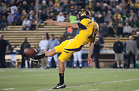 Bryan Anger punts the ball. The Oregon Ducks defeated the California Golden Bears 15-13 at Memorial Stadium in Berkeley, California on November 13th, 2010
