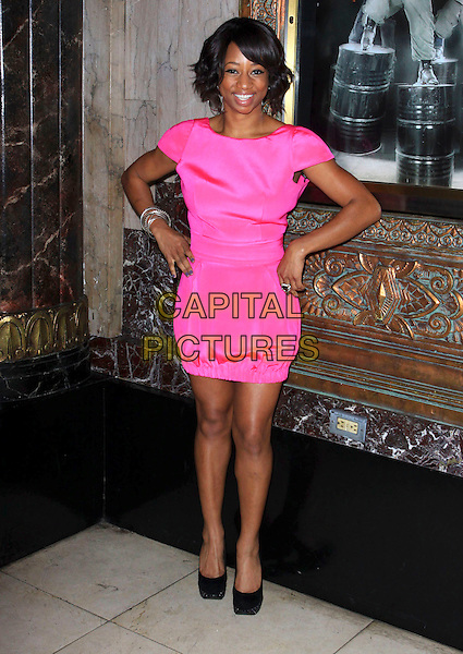 "MONIQUE COLEMAN .Opening Night Of ""STOMP"" held At The Pantages Theatre, Hollywood, California , USA, 26th January 2010..arrivals full length pink dress hands on hips black shoes .CAP/ADM/KB.©Kevan Brooks/AdMedia/Capital Pictures."