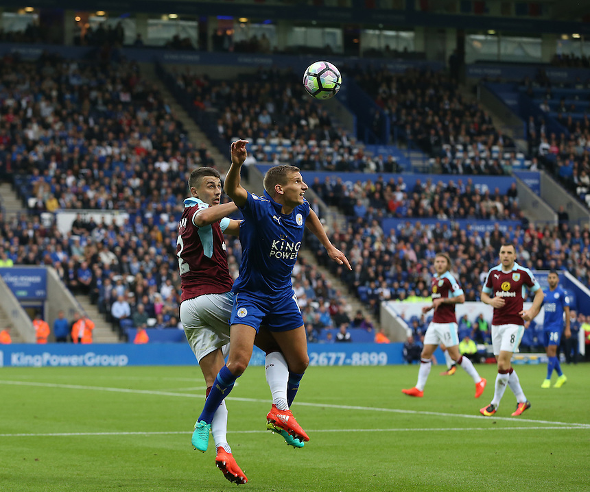 Leicester City's Marc Albrighton and Burnley's Matthew Lowton<br /> <br /> Photographer Stephen White/CameraSport<br /> <br /> The Premier League - Leicester City v Burnley - Saturday 17th September 2016 - King Power Stadium - Leicester <br /> <br /> World Copyright &copy; 2016 CameraSport. All rights reserved. 43 Linden Ave. Countesthorpe. Leicester. England. LE8 5PG - Tel: +44 (0) 116 277 4147 - admin@camerasport.com - www.camerasport.com