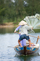 A fisherman casts his net on the Thu Bon River near Hoi An II.