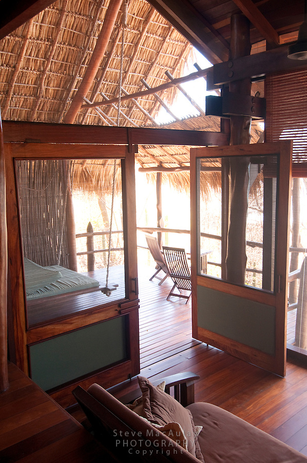 View from interior of bungalow out door to deck, Morgan's Rock Hacienda and Eco Lodge, Nicaragua