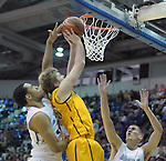 February 7, 2015 - Colorado Springs, Colorado, U.S. -  Air Force forward, DeLovell Earls #21, blocks a Cowboy layup during an NCAA basketball game between the University of Wyoming Cowboys and the Air Force Academy Falcons at Clune Arena, U.S. Air Force Academy, Colorado Springs, Colorado.  Air Force soars to a 73-50 win over Wyoming.