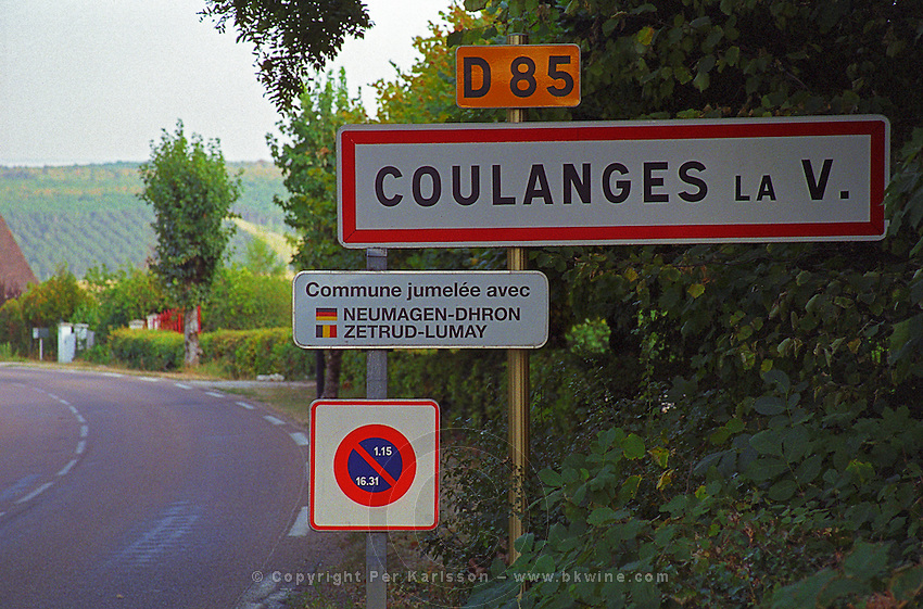 Road sign indicating the wine village Coulanges la Vineuse in northern Burgundy