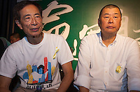 Veteran pro-democracy lawyer Martin Lee (L) and media tycoon Jummy Lai (R) are are seen at an overnight mass sit-in in front of Hong Kong's Central government offices, Hong Kong, China, 28 September 2014. It was announced at the student protest that the society-wide mass disobedience campaign, Occupy Central would commence immediatley - three whole days earlier than was previously forecast. The students and the Occupy Central supporters are protesting the slow pace of democratic reform imposed by the Chinese government on the Hong Kong people.