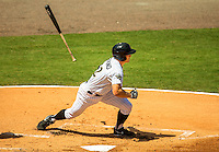 Sports action photography of the Charlotte Knights at their BB&T BallPark - located in Uptown Charlotte, NC. BB&T Ballpark is the home of the International League AAA Charlotte Knights baseball team. The  10,000 seat natural grass field is located against the beautiful Center City Charlotte skyline. The stadium overs a panoramic view of the Charlotte, North Carolina skyline.<br /> <br /> Charlotte Photographer - PatrickSchneiderPhoto.com