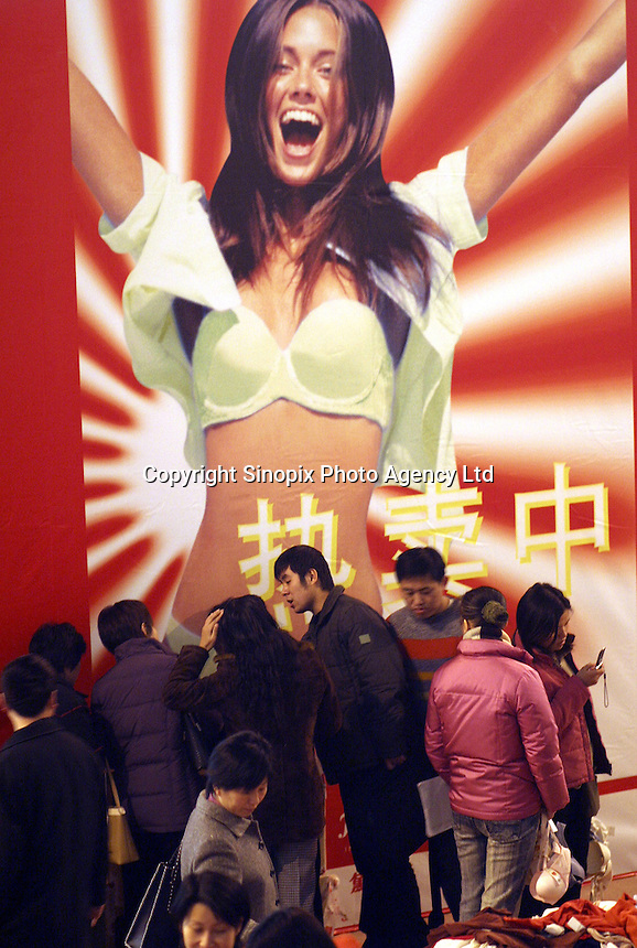 Exhibition goers sort through underwears at the Shanghai Underwear Exhibition in Shanghai, China. Although China produce most of the underwear worn by people around the world, it still has a lower per-capita underwear consumption than Western countries. However in large cities such as Shanghai, women are increasingly demanding more comfortable and sexier underwear and lingerie..29-DEC-03