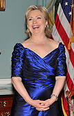 Washington, DC - December 5, 2009 -- United States Secretary of State Hillary Rodham Clinton enjoys a laugh as the 2009 Kennedy Center honorees assemble for the formal group photo following the Artist's Dinner at the United States Department of State in Washington, D.C. on Saturday, December 5, 2009.  .Credit: Ron Sachs - Pool via CNP