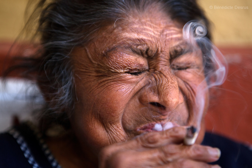 Carmelita, a resident of Casa Xochiquetzal, enjoys smoking her daily cigarette at the shelter in Mexico City, Mexico on April 25, 2012. One day, Carmelita's son abandoned her on the subway because his wife didn't want to take care of her and didn't want to live under the same roof with a sex worker. Asked to choose between his wife and his mother, Carmelita's son deserted his mother. Casa Xochiquetzal is a shelter for elderly sex workers in Mexico City. It gives the women refuge, food, health services, a space to learn about their human rights and courses to help them rediscover their self-confidence and deal with traumatic aspects of their lives. Casa Xochiquetzal provides a space to age with dignity for a group of vulnerable women who are often invisible to society at large. It is the only such shelter existing in Latin America. Photo by Bénédicte Desrus