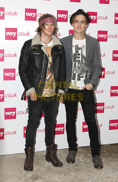 Dougie Poynter and Tom Fletcher - McFly.The Very.co.uk Fashion Preview for Spring and Summer 2012, Mercer Studios, London, England..September 20th, 2011.LFW full length black jeans denim leather jacket sheepskin grey gray hat white.CAP/ROS.©Steve Ross/Capital Pictures