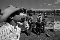 A man drinks a beer at the annual Lincoln Rodeo in Lincoln, MT in June 2006.  The Lincoln Rodeo is an open rodeo, which means competitors need not be a member of a professional rodeo association.