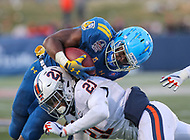 Annapolis, MD - December 28, 2017: Navy Midshipmen running back Josh Brown (28) gets tackled by Virginia Cavaliers safety Juan Thornhill (21) during the game between Virginia and Navy at  Navy-Marine Corps Memorial Stadium in Annapolis, MD.   (Photo by Elliott Brown/Media Images International)