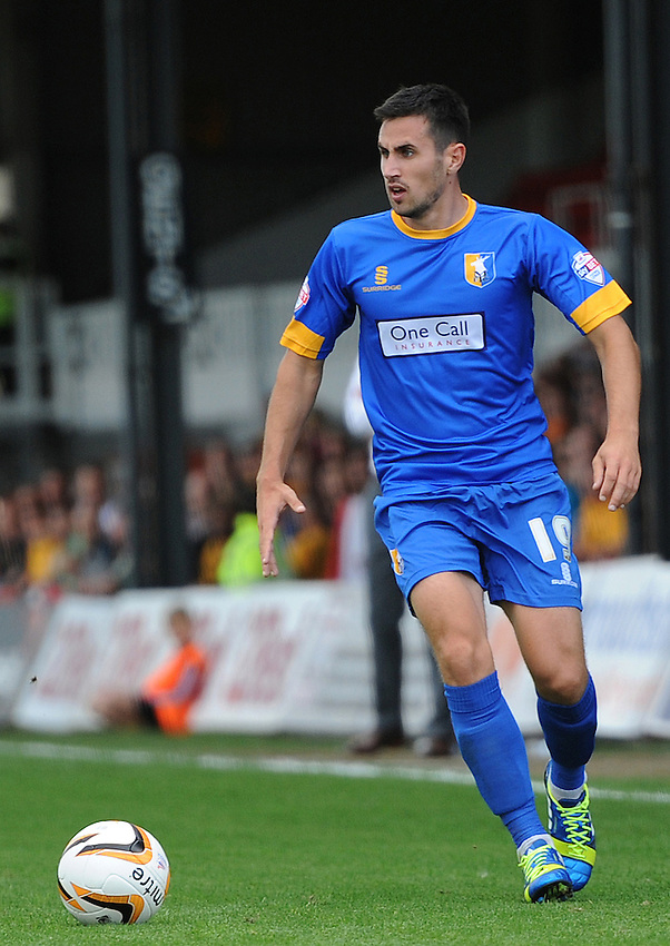 Mansfield Town's Chris Clements in action during todays match  <br /> <br /> (Photo by Ashley Crowden/CameraSport)<br /> <br /> Football - The Football League Sky Bet League Two - Newport County v Mansfield Town - Saturday 7th September 2013 - Rodney Parade - Newport<br /> <br /> &copy; CameraSport - 43 Linden Ave. Countesthorpe. Leicester. England. LE8 5PG - Tel: +44 (0) 116 277 4147 - admin@camerasport.com - www.camerasport.com