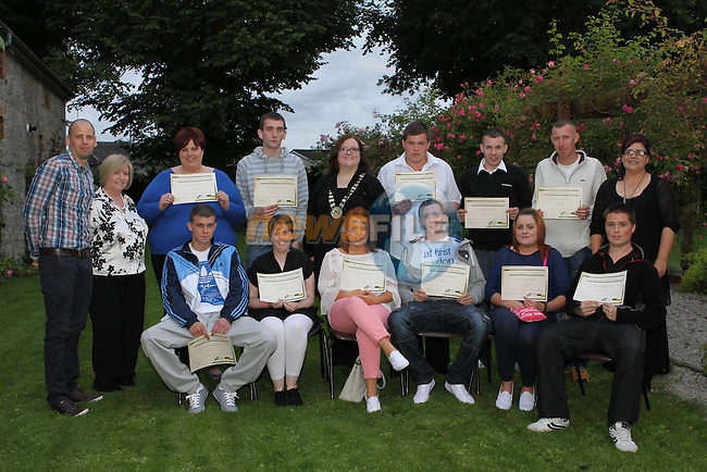 Back Row - Coordinator Simon McCabe, Caroline from FAS, Claire O'Brien, Donal Kavanagh, Cathaoirleach Cllr Niamh McGowan, Francis Hughes, Gerard Goughran, Jerome O'Brien, Coordinator Alison Digney . Front Row - Fran Walshe, Leanne Clarke, Aoife Duggan, Matthew Healy, Sarah Lawless and Anthony Clarke at the Certificate Award Ceremony for the Ecco training Course in Duleek...(Photo credit should read Jenny Matthews/NEWSFILE)...