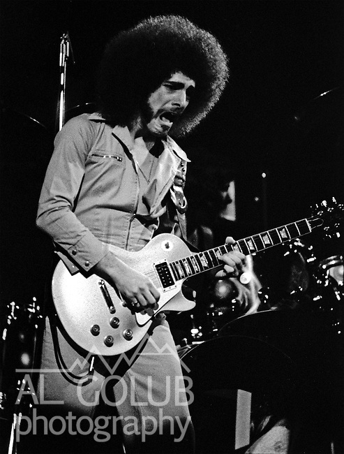 Neal Schon on lead guitar.FRESNO, California--Some time in 1976, traveled with Bill Barr of Rock'n Chair Production  to see Electric Light Orchestra, Journey and Little Feat in Fresno Memorial Auditorium.  ElO members: Jeff Lynne, Bev Bevan, Richard Tandy, Mik Kaminski, Kelly Groucutt, Hugh McDowell and Melvyn Gale.  1975 - 1978 were big years for ELO.  Journey included Neal Schon on lead guitar, Gregg Rolie on keyboards and lead vocals, bassist Ross Valory and rhythm guitarist George Tickner.  Little Feat's classic line-up: Bill Payne, Richie Hayward, Sam Clayton, Lowell George, Paul Barrere and Kenny Gradney,  Photo by Al Golub/Golub Photography