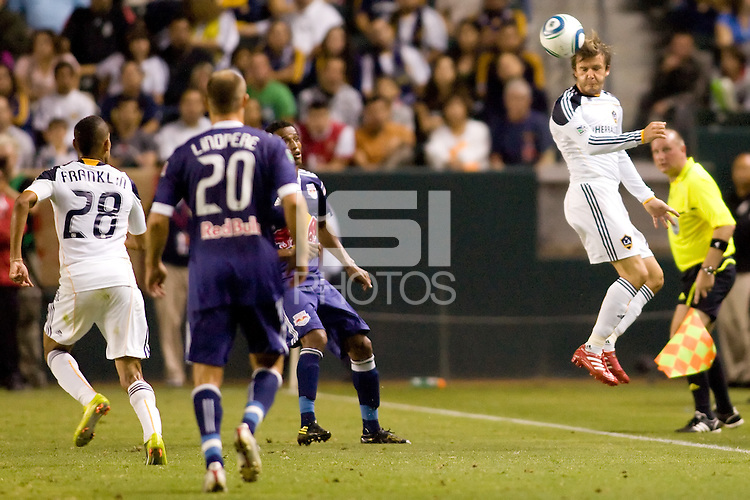 LA Galaxy midfielder David Beckham heads ball down field. The New York Red Bulls beat the LA Galaxy 2-0 at Home Depot Center stadium in Carson, California on Friday September 24, 2010.