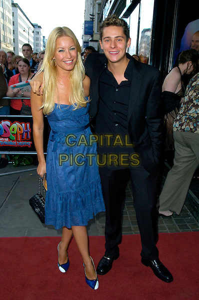 DENISE VAN OUTEN & CHRIS PARKER.Joseph & The Amazing Technicolor Dreamcoat - press night, the Adelphi Theatre, London, England..July 17th, 2007.full length blue strapless dress christopher shoes pattern black suit hand in pocket purse bag .CAP/CAN.©Can Nguyen/Capital Pictures