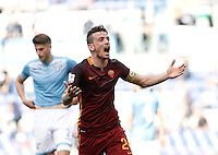 Calcio, Serie A: Lazio vs Roma. Roma, stadio Olimpico, 3 aprile 2016.<br /> Roma's Alessandro Florenzi celebrates after his teammate Diego Perotti scored during the Italian Serie A football match between Lazio and Roma at Rome's Olympic stadium, 3 April 2016.<br /> UPDATE IMAGES PRESS/Isabella Bonotto