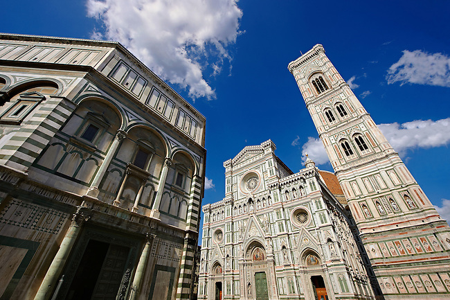 View of the Facade of the the Gothic-Renaissance Duomo of Florence,  Basilica of Saint Mary of the Flower; Firenza ( Basilica di Santa Maria del Fiore ), and its campinale & Baptistry  from Piazza del Duomo.  Built between 1293 & 1436. Italy