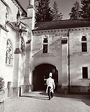 FRANCE, Burgundy, chef walking in courtyard outside Abbaye De La Bussiere Restaurant and Hotel, Dijon (B&W)