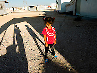 Another nice picture of my little sister Summaia waiting for the falafel that my uncle makes. In the picture I see my shadow.