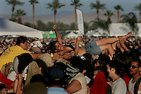 Indio, Ca.- A fan is pulled from the crowd during the Arcade Fire performance at Coachella Valley Music and Arts Festival, Saturday, April 28, 2007.