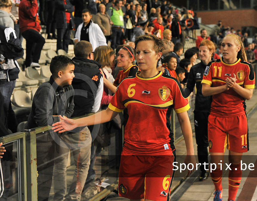 20130921 - BRUSSELS , BELGIUM : Belgian Niki De Cock pictured thanking the fans after the female soccer match between Belgium and Albania , on the first matchday in group 5 of the UEFA qualifying round to the FIFA Women World Cup in Canada 2015 at the Koning Boudewijn Stadion , Brussels . Saturday 21th September 2013. PHOTO DAVID CATRY