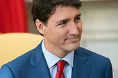 Canadian Prime Minister Justin Trudeau listens to US President Donald J. Trump (not pictured) in the Oval Office of the White House in Washington, DC, USA, 20 June 2019. The president spoke to the media about Iran shooting down an American drone, saying it might not have been intentional.<br /> Credit: Jim LoScalzo / Pool via CNP