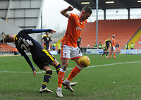 Blackpool's Oliver Turton under pressure from Oxford United's Mark Sykes<br /> <br /> Photographer Kevin Barnes/CameraSport<br /> <br /> The EFL Sky Bet League One - Blackpool v Oxford United - Saturday 23rd February 2019 - Bloomfield Road - Blackpool<br /> <br /> World Copyright © 2019 CameraSport. All rights reserved. 43 Linden Ave. Countesthorpe. Leicester. England. LE8 5PG - Tel: +44 (0) 116 277 4147 - admin@camerasport.com - www.camerasport.com