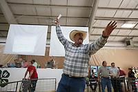 Auctioneer  sells livestock at the NW Washington Fair. August 21, 2009 PHOTOS BY MERYL SCHENKER            .schenker IMG_9632.JPG