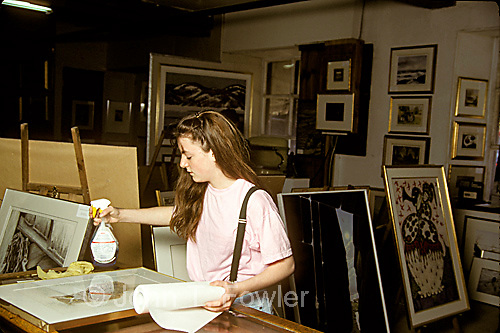 Teen aged woman working in art framing shop