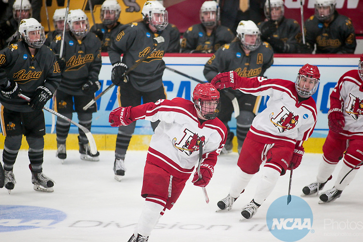 ADRIAN, MI - MARCH 18: Melissa Sheeran (26) of Plattsburgh State University celebrates her goal in the first period of the Division III Women's Ice Hockey Championship held at Arrington Ice Arena on March 19, 2017 in Adrian, Michigan. Plattsburgh State defeated Adrian 4-3 in overtime to repeat as national champions for the fourth consecutive year. by Tony Ding/NCAA Photos via Getty Images)