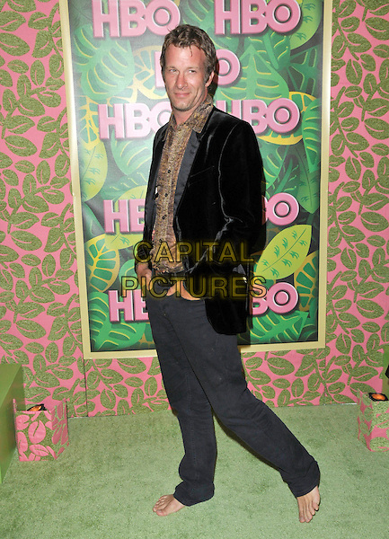 THOMAS JANE.The HBO Post Emmy party held at The Plaza at The Pacific Design Center in Beverly Hills, California, USA..August 29th, 2010                                                                    .full length barefoot no shoes black jacket grey gray trousers brown shirt .CAP/RKE/DVS.©DVS/RockinExposures/Capital Pictures.