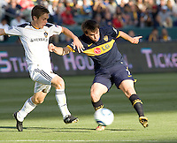 LA Galaxy midfielder Michael Stephens (26) battles Boca Juniors midfielder Gaston Rossi (16). The LA Galaxy defeated Boca Juniors 1-0 at Home Depot Center stadium in Carson, California on Sunday May 23, 2010.  .