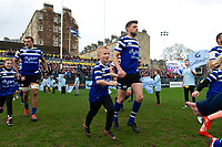 Rhys Priestland of Bath Rugby mascot in hand runs out onto the field. Gallagher Premiership match, between Bath Rugby and Harlequins on March 2, 2019 at the Recreation Ground in Bath, England. Photo by: Patrick Khachfe / Onside Images