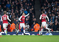 Mesut Ozil of Arsenal celebrates scoring the opening goal during the Premier League match between Arsenal and Newcastle United at the Emirates Stadium, London, England on 16 December 2017. Photo by Vince  Mignott / PRiME Media Images.