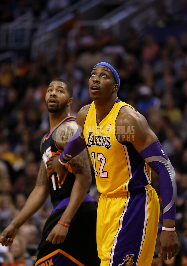 Jan. 30, 2013; Phoenix, AZ, USA: Los Angeles Lakers center Dwight Howard (12) against Phoenix Suns forward Markieff Morris at the US Airways Center. Mandatory Credit: Mark J. Rebilas-