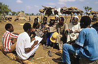Extension workers discussing with villagers about new agricultural practices