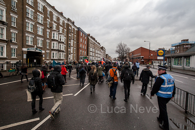 "London, 31/01/2015. At the end of ""The March For Homes"", some activists tried symbolically to occupy the luxury housing development called ""One Tower Bridge"". The demonstration ended, after a short march, at the Aylesbury Estate (""one of the most notorious estates in the United Kingdom"", located in Walworth, South East London) where some boarded up homes, ready to be demolished ""to regenerate and revitalise the area"", were reclaimed and reoccupied by activists."