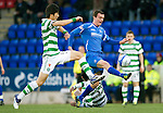 St Johnstone v Celtic...18.12.11   SPL .Ki Sung Yeung and David Robertson.Picture by Graeme Hart..Copyright Perthshire Picture Agency.Tel: 01738 623350  Mobile: 07990 594431