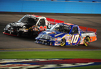 Nov. 13, 2009; Avondale, AZ, USA; NASCAR Camping World Truck Series driver James Buescher (10) races alongside Todd Bodine during the Lucas Oil 150 at Phoenix International Raceway. Mandatory Credit: Mark J. Rebilas-