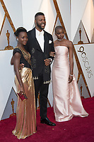 Lupita Nyong'o, Winston Duke and Danai Gurira arrive on the red carpet of The 90th Oscars&reg; at the Dolby&reg; Theatre in Hollywood, CA on Sunday, March 4, 2018.<br /> *Editorial Use Only*<br /> CAP/PLF/AMPAS<br /> Supplied by Capital Pictures