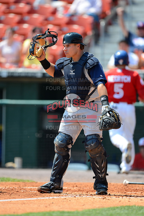 Charlotte Knights catcher Josh Phegley #4 during a game against the Buffalo Bisons on May 19, 2013 at Coca-Cola Field in Buffalo, New York.  Buffalo defeated Charlotte 11-6.  (Mike Janes/Four Seam Images)
