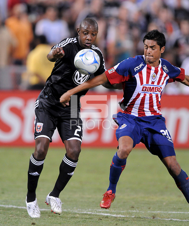 DC United defender Gonzalo Martinez (23) tries to keep control of the ball against CD Guadalajara forward Sergio Santana (21), CD Guadalajara  defeated DC United 2-1 in the opening game of the SuperLiga tournament, Saturday July 12, 2008 at Robert F. Kennedy Memorial Stadium.