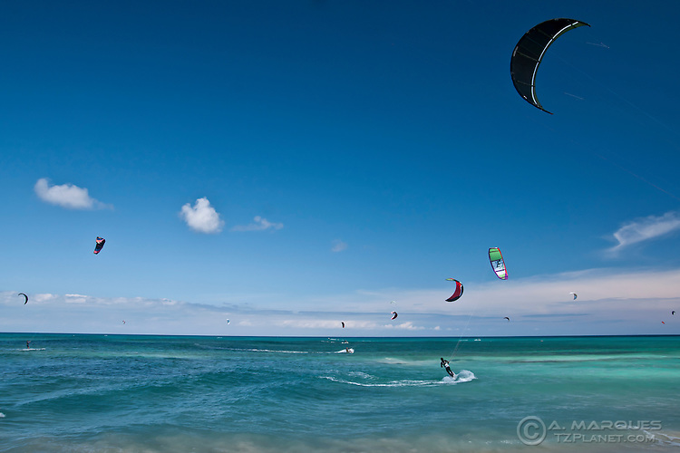 Kitesurfing / kiteboarding is a very popular water sport in Fuerteventura, Canary Islands, Spain. The east coast, with sandy beaches and strong winds, is a popular destination for water sports like windsurfing and kiteboarding. Dozens of kitebraders can sometimes be seen in the water. Many water sports schools cater for the beginners, the large majority of which are tourists.