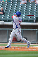 Dan Vogelbach (21) of the Tennessee Smokies follows through on his swing against the Birmingham Barons at Regions Field on May 4, 2015 in Birmingham, Alabama.  The Barons defeated the Smokies 4-3 in 13 innings. (Brian Westerholt/Four Seam Images)