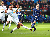 17th March 2018, Liberty Stadium, Swansea, Wales; FA Cup football, quarter-final, Swansea City versus Tottenham Hotspur Christian Eriksen of Tottenham Hotspur curls his shot around Kyle Bartley of Swansea City to find the top corner of the net scoring his sides 1st goal of the game in the 12th minute