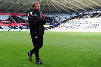 Billy Reid, assistant manager for Swansea City applauds the fans at the final whistle during the Sky Bet Championship match between Swansea City and Hull City at the Liberty Stadium in Swansea, Wales, UK. Saturday 27 April 2019