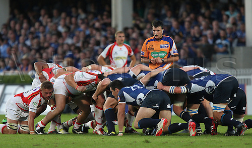 08.09.2012 Dublin, Ireland. Referee Marius Mitrea, overseas the scrum, during the RaboDirect PRO12 Rugby game between Leinster and Newport Gwent Dragons from the RDS Arena.