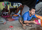 28 August 2019, Jakarta, Indonesia: Sayed Alishah, 37 from Afghanistan, washes his face at his camp in the grounds at the UNHCR refugee centre in Kalideres, Jakarta.  Plans to re-locate the overcrowded refugees have been fast tracked after a fight broke out between the groups, many of whom have been in Indonesia for years waiting for placement. Tensions ran high between Afghan and African groups in the centre with a lack of adequate food for the refugees being the catalyst. The African groups, who were moved onto the footpath, were being bussed out today. Conditions in the centre are grim and the local Indonesian population not happy with the refugees presence in the suburb.Picture by Graham Crouch/The Australian