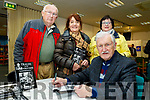 John Cleary signs copies of his new book, Tralee in the good old days, for L-R John, Norah&Peggy Ashe, at his book launch in the Tralee Library last Tuesday evening Nov 19.